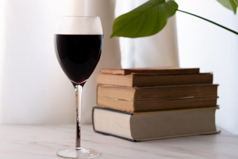 Wine books, reading. Photo by Kelly Visel, Unsplash
