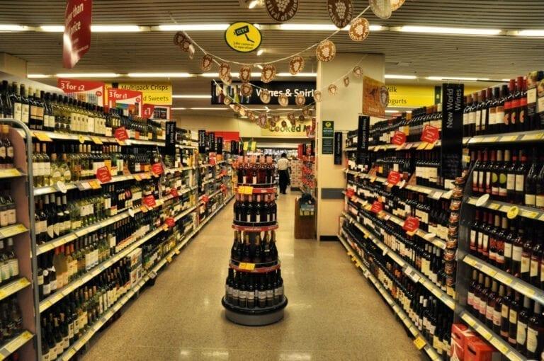 Aisle inside wine shop showing bottles of wine