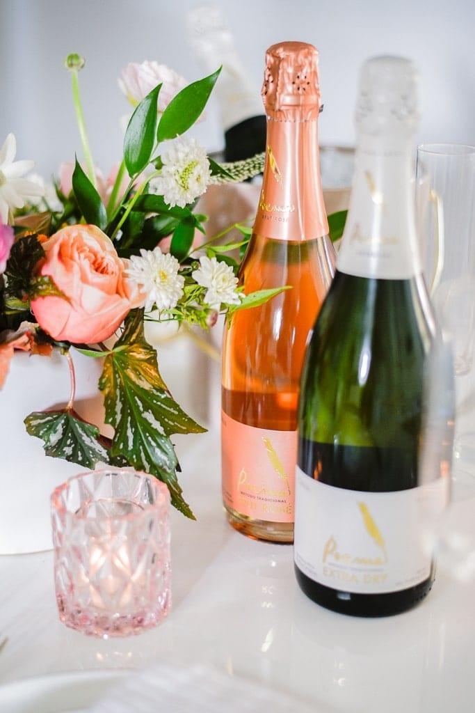 Poema Cava flowers, wine, bottles