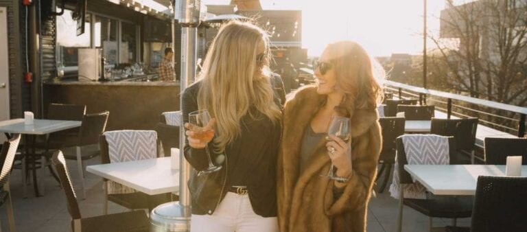 Girls on rooftop with rose wine