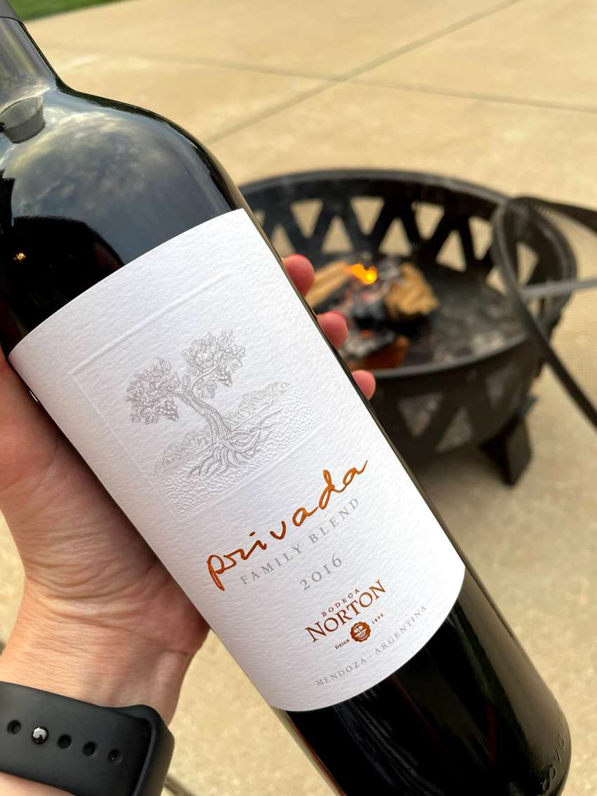 Bodega Norton wine bottle in hand