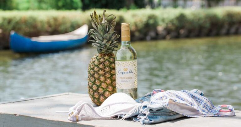 White wine by lake and pineapple