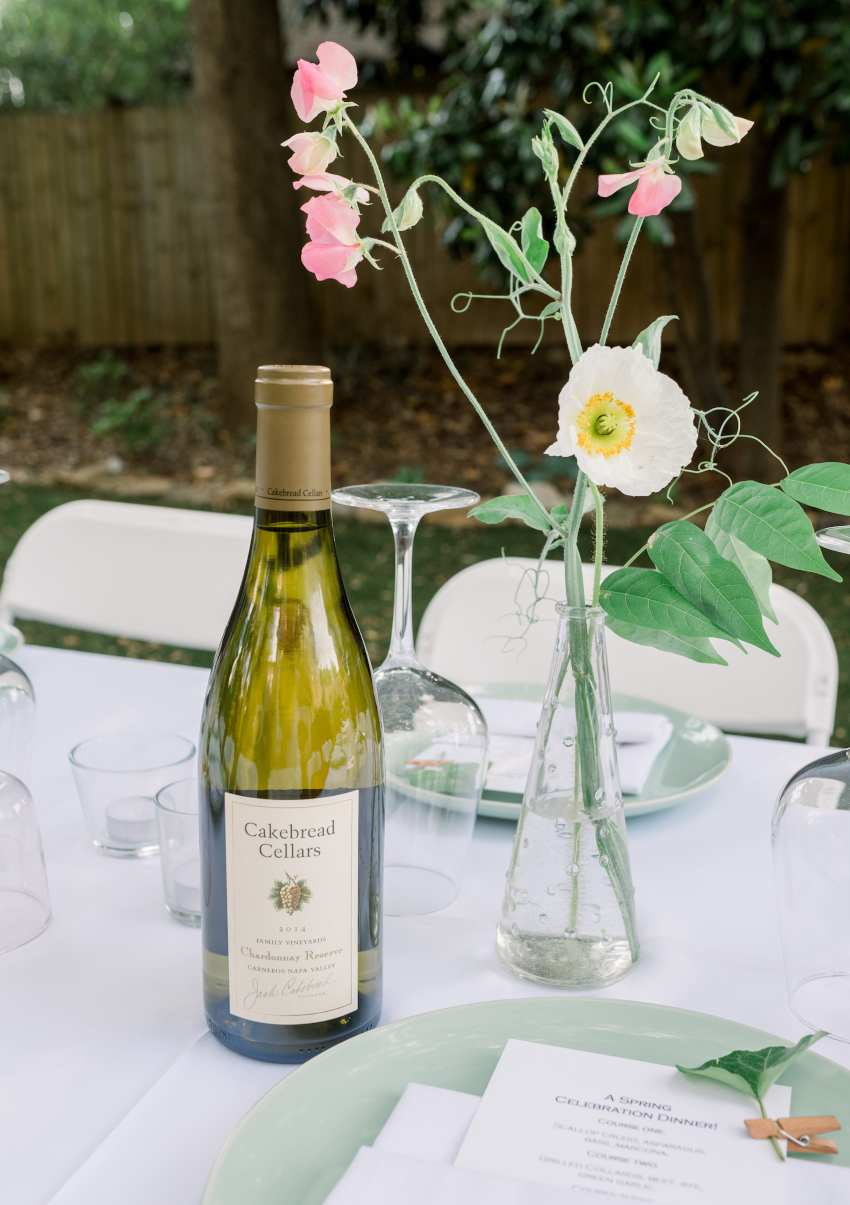 Flowers and wine on table