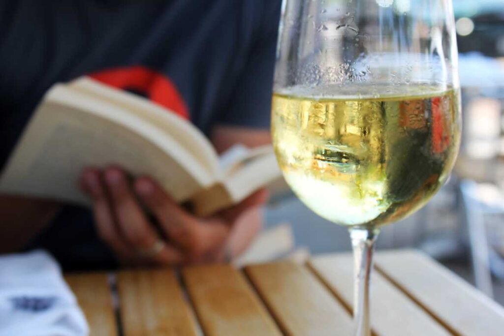 Wine and book by Quinn Dombrowski