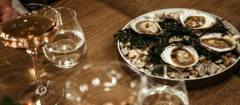 Oysters and white wine on table