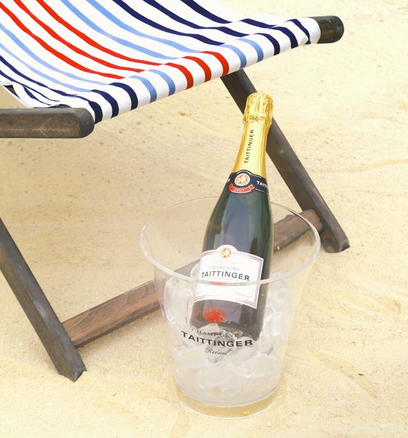 Champagne in ice bucket on beach