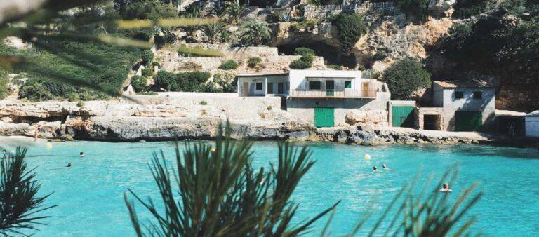 Beach, blue sea, and palm trees in Majorca, Spain