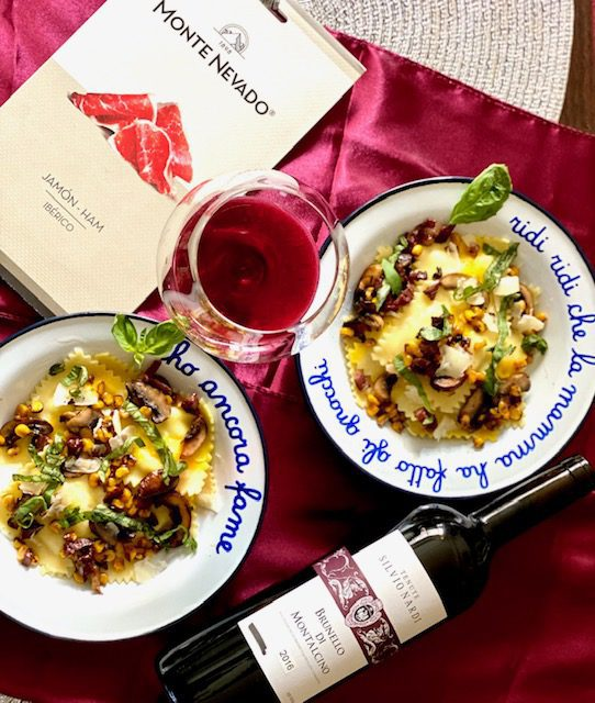 Brunello wine with pasta in two bowls