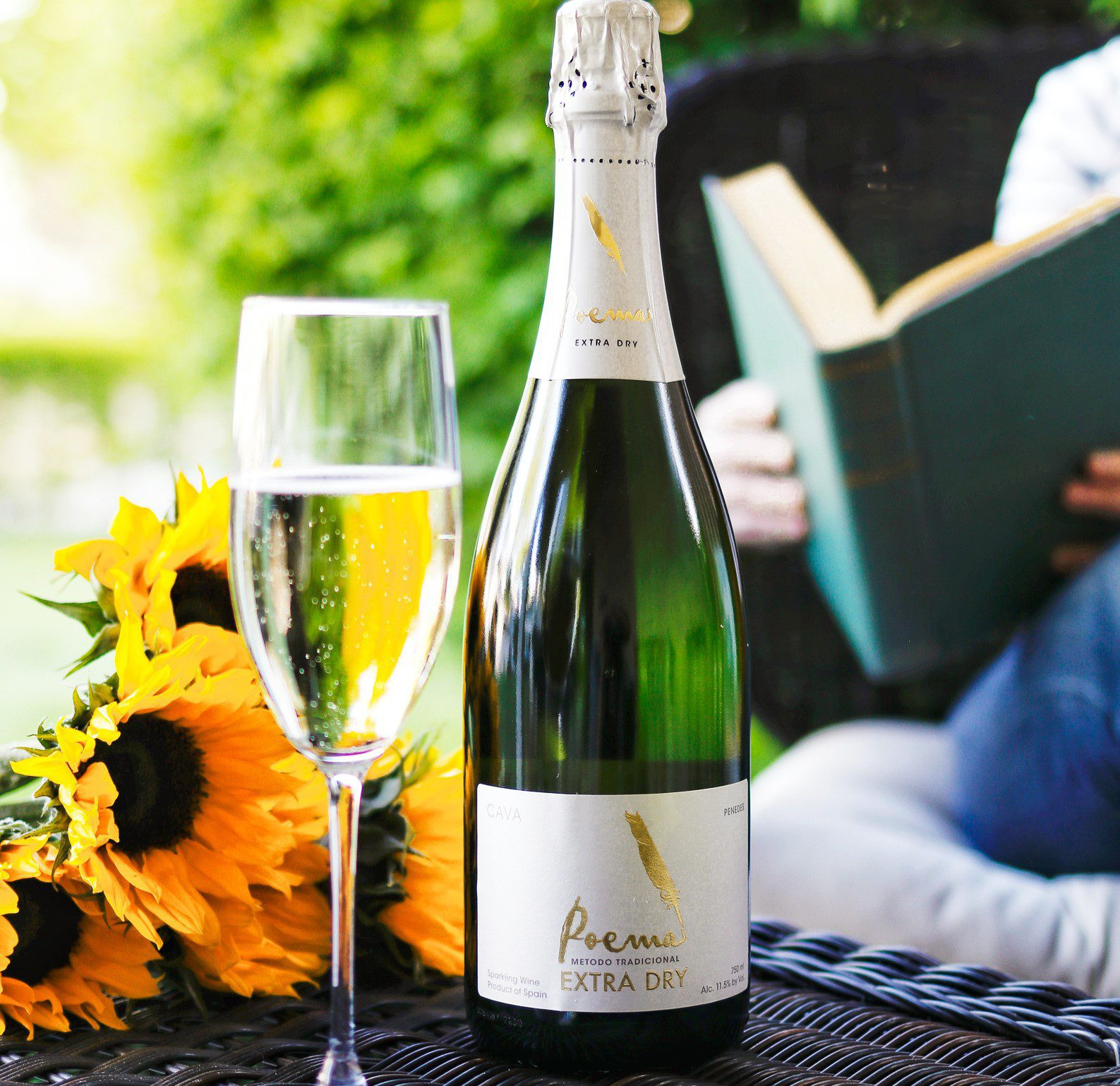 Poema Cava and reading a book with sunflowers